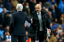 Manchester City manager Pep Guardiola shakes hands with Stoke City manager Mark Hughes - Mandatory by-line: Matt McNulty/JMP - 08/03/2017 - FOOTBALL - Etihad Stadium - Manchester, England - Manchester City v Stoke City - Premier League