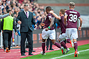 Craig Levein, manager of Heart of Midlothian celebrates with Arnaud Djoum (#10) of Heart of Midlothian after the first goal during the Ladbrokes Scottish Premiership match between Heart of Midlothian and Aberdeen at Tynecastle Stadium, Edinburgh, Scotland on 20 October 2018.