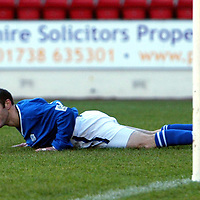 St Johnstone v Raith Rovers...24.01.04<br />Brian McLaughlin smiles after steering the ball past Raith keeper Ramiro Gonalez for St Johnstone's second goal<br />Picture by Graeme Hart.<br />Copyright Perthshire Picture Agency<br />Tel: 01738 623350  Mobile: 07990 594431