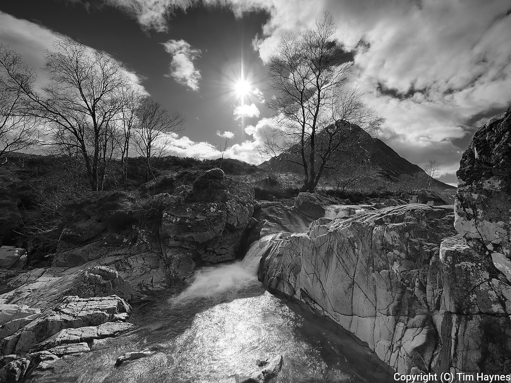 Shows what a difference there is with low water levels in summer.<br /> <br /> A classic scene, the Buachaille Etive Mor from the rockery in the River Coupall.