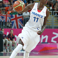 30 July 2012: Emilie Gomis of France looks to pass the ball during the 74-70 Team France overtime victory over Team Australia, during the women's basketball preliminary, at the Basketball Arena, in London, Great Britain.