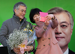 Moon Jae-in (L), presidential candidate of South Korea's Democratic United Party, has a picture taken with a supporter during the election campaign in Incheon, South Korea, December 17, 2012, Photo by Imago / i-Images...UK ONLY