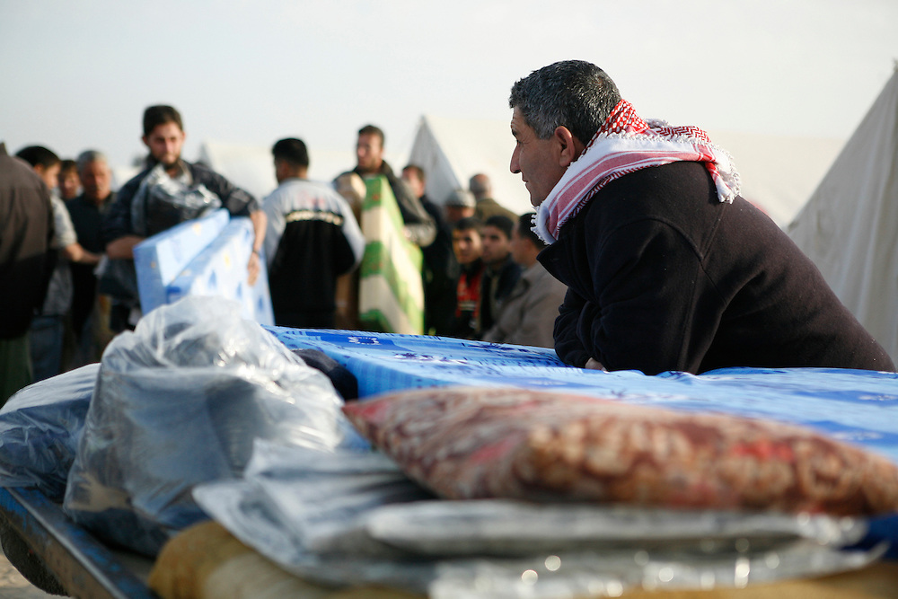 In the midst of their ongoing siege of the Gaza Strip, on 27 December Israel launched attacks by air, land and sea against the 1.5 million Palestinians of Gaza. The attacks, said to put an end to homemade rocket fire from armed groups in Gaza into Israel, left more than 1,300 Palestinians killed, the majority of whom were civilians including almost 450 children. Thousands of homes and businesses were also destroyed throughout the territory.///Blankets and mattresses are handed out to Palestinians whose homes were destroyed in Israeli attacks in the Gaza Strip.