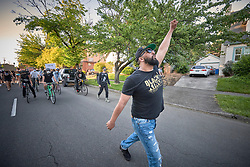 Isiah Wagoner leads a June 3, 2020, Black Lives Matter protest through a residential section of Eugene, Oregon. Participants were protesting the murder of George Floyd and other African-Americans by police.