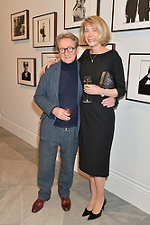 JOHN SWANNELL and MARIANNE SWANNELL at a private view of photographs by David Bailey entitled 'Bailey's Stardust' at the National Portrait Gallery, St.Martin's Place, London on 3rd February 2014.
