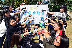 September 30, 2016 - Liaocheng, Liaocheng, China - Liaocheng, CHINA-September 29 2016:?(EDITORIAL?USE?ONLY.?CHINA?OUT) Volunteers show animal themed hand paintings in Liaocheng, Shandong Province. Volunteers from Fine Arts College of Liaocheng University organize an activity of hand painting in Liaocheng, east China¬°¬Øs Shandong Province, September 29th, 2016, marking the upcoming World Animal Day which falls on October 4th, 2016. The volunteers make various animal themed hand paintings, appealing the public to protect animals. (Credit Image: © SIPA Asia via ZUMA Wire)
