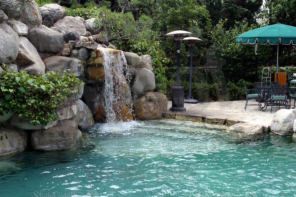 Jul 21, 2002; Holmby Hills, California, USA; Enterance to the infamous grotto lagoon at the Playboy Mansion.<br /> <br /> 1973, famed Playboy publisher/editor Hugh Hefner introduced the world to his version of a modern-day Xanadu, the iconic property known as the Playboy Mansion West. A wildly imaginative adult playground, the property conveyed the extreme luxury and personal freedom that reflected the cultural ethos embodied in Hefner&rsquo;s revolutionary publication.<br /> <br /> Located in Holmby Hills, a wealthy Los Angeles enclave famous for its celebrity residents, the 5.3-acre estate features a 29-room Gothic/Tudor estate home originally built in 1927. Hefner purchased the property in 1970 and quickly set in motion a massive renovation that would result in one of the most photographed, distinctive and storied residences of the 20th Century.