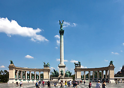 Millennium Monument in Heroes's Square, Budapest, centers on a large stone cenotaph surrounded by an ornamental iron chain. and is flanked by matching colonnades.  Each of the latter contain seven statues representing great figures in Hungary's history.