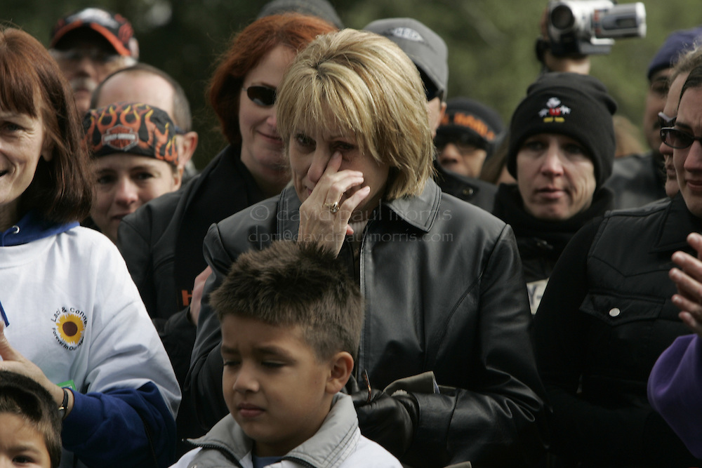 Modesto, CA - NOVEMBER 20: Sharon Rocha,  Laci Peterson's mother wipes away a tear during a brief stop at the Burwood Cemetery in Escalon where Laci Peterson is buried in Escalon, California. Over 2,000 people take part in the second annual Laci Peterson Memorial Motorcycle ride in Modesto, California on Saturday November 20, 2004. Laci was murdered along with her unborn son, Conner in December 2002 by her husband Scott Peterson who was found guilty of  first degree of murder by a San Mateo, California jury on November 12, 2004 and could face the death penalty. Photograph by David Paul Morris