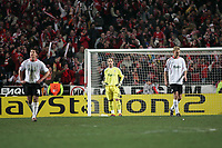 Photo: Lee Earle.<br /> Benfica v Liverpool. UEFA Champions League. 2nd Round, 1st Leg. 21/02/2006. Liverpool keeper Jose Reina (C), Xabi Alonso (L) and Sami hyypia look dejected after Benfica scored.