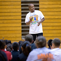 "060613       Adron Gardner\Independent<br /> <br /> Gallup girls basketball coach Kamau Turner speaks to the girls and boys basketball camp at Gallup High School in Gallup Thursday.  ""Before you learn how to do it fast, you have to learn how to do it right,"" Turner said."