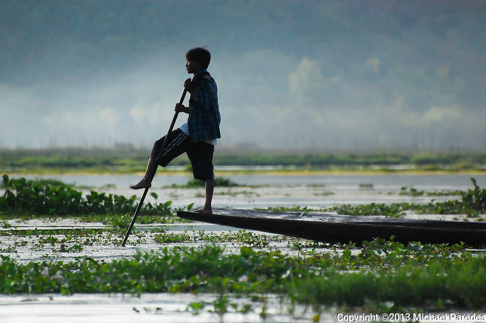 Fishermen can be seen very early in the morning on their longtail boats  on Inlé Lake in Burma (Myanmar)