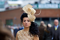 LIVERPOOL, ENGLAND - Thursday, April 6, 2017: A race goer with a gold bow hat and Chanel earrings, during The Opening Day on Day One of the Aintree Grand National Festival 2017 at Aintree Racecourse. (Pic by David Rawcliffe/Propaganda)