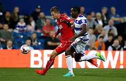Luke Norris of Swindon Town runs with the ball past Nedum Onuoha of Queens Park Rangers - Mandatory by-line: Robbie Stephenson/JMP - 10/08/2016 - FOOTBALL - Loftus Road - London, England - Queens Park Rangers v Swindon Town - EFL League Cup