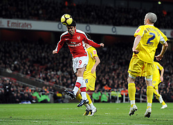 Eduardo scores the first goal during the FA Cup 4th Round Replay between Arsenal and Cardiff City at the Emirates Stadium on February 16, 2009 in London, England