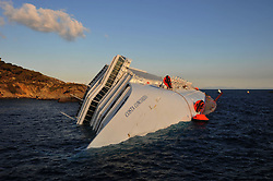 "The Wrecked Cruise Ship ""Costa Concordia"" in Giglio, Italy, as the ship starts to move. Photo By Nick Cornish/ I-Images."