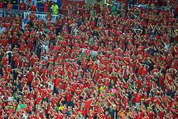 LYON, FRANCE - Wednesday, July 6, 2016: Wales supporters applaud the team after the UEFA Euro 2016 Championship Semi-Final defeat to Portugal at the Stade de Lyon. (Pic by Paul Greenwood/Propaganda)