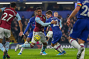Chelsea midfielder Christian Pulisic (22) tussles with Aston Villa defender Ezri Konsa (15) during the Premier League match between Chelsea and Aston Villa at Stamford Bridge, London, England on 4 December 2019.