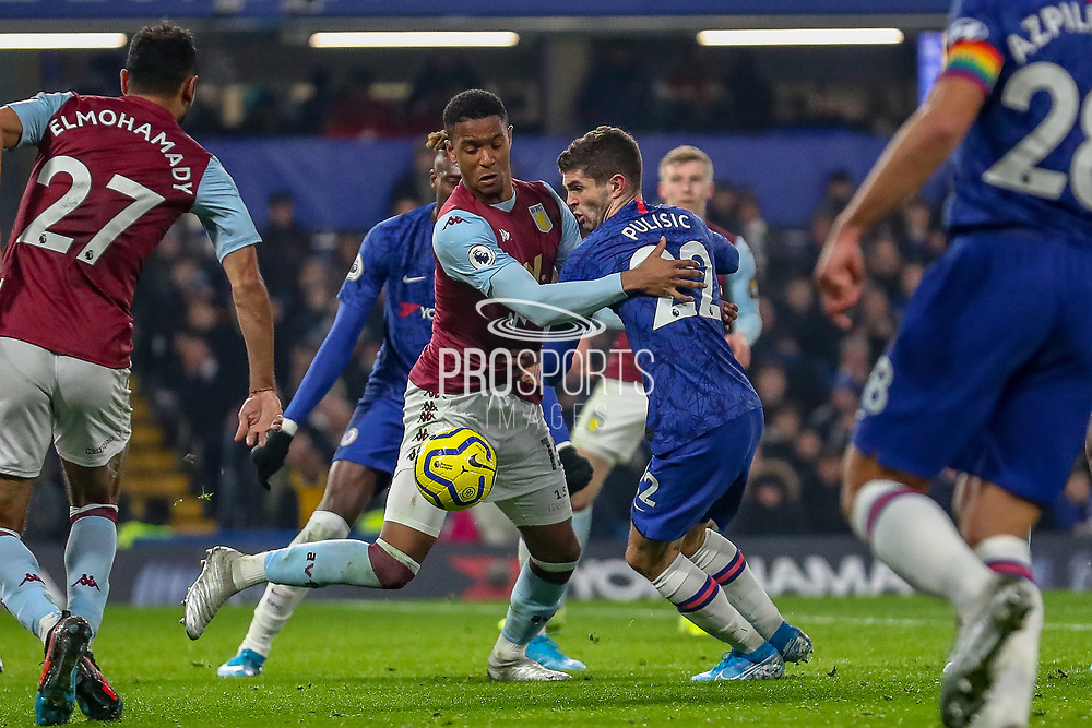 Chelsea midfielder Christian Pulisic (22) tussles with Aston Villa defender Ezri Konsa (15) during the Premier League match between Chelsea and Aston Villa at Stamford Bridge, London, England on 4 December 2019.