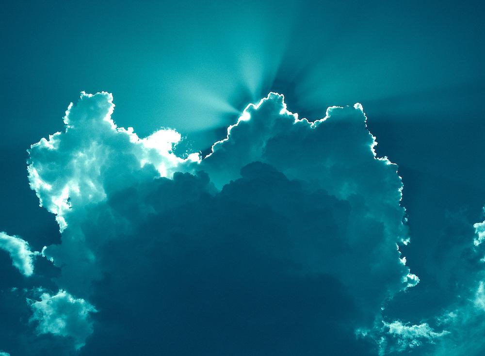 Blue clouds with sunburst