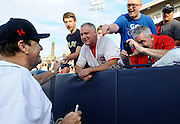 Pete Rose, left, signs autographs for fans before a game at The Ballpark at Harbor Yard, Monday, June 16, 2014, in Bridgeport, Conn. Rose, banned from Major League Baseball, returned to the dugout for one day to manage the independent minor-league Bridgeport Bluefish. (AP Photo/Jessica Hill)