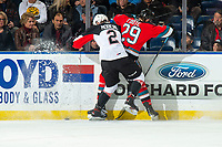 KELOWNA, BC - NOVEMBER 30: Cole Moberg #2 of the Prince George Cougars checks Nolan Foote #29 of the Kelowna Rockets at the boards during first period at Prospera Place on November 30, 2019 in Kelowna, Canada. (Photo by Marissa Baecker/Shoot the Breeze)