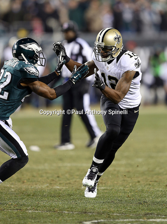 New Orleans Saints wide receiver Marques Colston (12) works off bump coverage as he goes out for a pass during the NFL NFC Wild Card football game against the Philadelphia Eagles on Saturday, Jan. 4, 2014 in Philadelphia. The Saints won the game 26-24. ©Paul Anthony Spinelli
