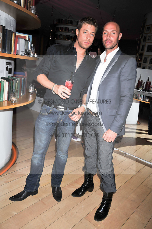 Left to right, DUNCAN JAMES and JASON GARDINER at the St.Martins Lane Hotel 10th year bash held on 9th September 2009.