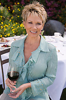 Woman drinking wine outdoors, portrait