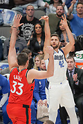 Dallas Mavericks power forward Maxi Kleber (42) shoots over Toronto Raptors center Marc Gasol (33) during an NBA basketball game, Saturday, Nov. 16, 2019, in Dallas. The Mavericks defeated the Raptors 110-102. (Wayne Gooden/Image of Sport)