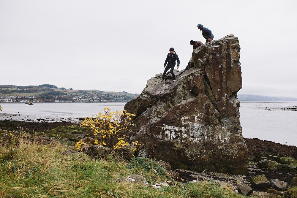 Scott Quin, Jason Phelan and Kriss Kyle explore the rocks on the coast in Dumbarton, Scotland.