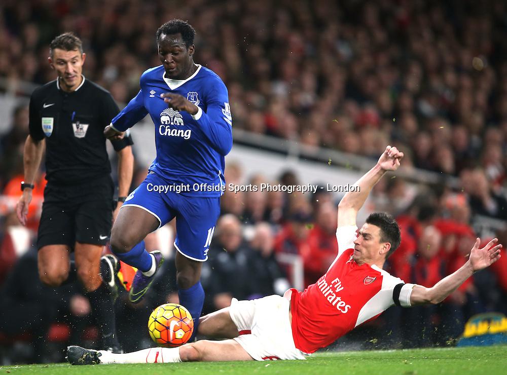 24 October 2015 Premier League Football - Arsenal v Everton : Romelu Lukaku eveades the sliding tackle of Laurent Koscielny.<br /> Photo: Mark Leech