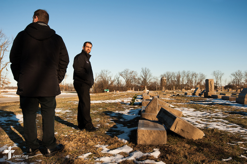 Rev. Ross E. Johnson (facing camera), director of LCMS Disaster Response, and Rev. Michael W. Meyer, manager of LCMS Disaster Response, tour the damaged cemetery grounds of Saint John Lutheran Church in New Minden, Ill., on Wednesday, Dec. 18, 2013. The tornado that damaged the church and surrounding homes in November was one among nearly two dozen that swept through the state, killing a total of seven. LCMS Communications/Erik M. Lunsford