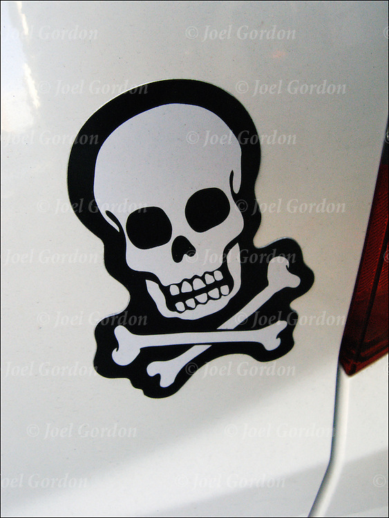 Magnetic Skull and Cross Bones on back of automobile, This symbol can have many meaning:  Death or dead, danger, toxic, pirate.