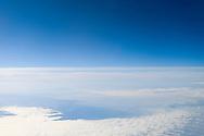 Italie, 20141128.<br /> Boven de wolken<br /> Vanuit het vliegtuig op grote hoogte. Strak blauwe lucht, neerkijkend op witte watten wolken. Verstild landschap<br /> <br /> Italy, 20141128.<br /> Above the clouds<br /> From the plane at high altitude. Blue sky, looking down on white cotton clouds. serene landscape