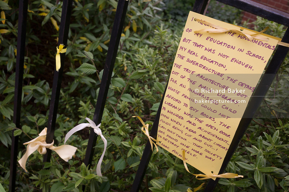 Campaigners locked out of the closed Carnegie Library have tied yellow ribbons and messages to the railings in Herne Hill, south London on 7th May 2016. For ten days, members of the community in the south London borough occupied their important resource for learning and social hub for the weekend. But after a long campaign by locals, Lambeth have gone ahead and closed the library's doors because they say, cuts to their budget mean millions must be saved. A gym is planned to replace the working library and while some of the 20,000 books on shelves will remain, no librarians will be present to administer it. London borough's budget cuts mean four of its 10 libraries will either close, move or be run by volunteers.
