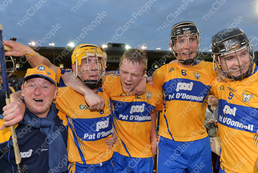 7 August 2013; Clare players, from left, Colm Galvin, Aaron Cunningham, Alan O'Neill and Tony Kelly celebrate with a supporter after the final whistle. Bord Gáis Energy Munster GAA Hurling Under 21 Championship Final, Tipperary v Clare, Semple Stadium, Thurles, Co. Tipperary. Picture credit: Matt Browne / SPORTSFILE *** NO REPRODUCTION FEE ***