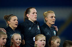 CARDIFF, WALES - Friday, November 24, 2017: Wales' Loren Dykes, goalkeeper Laura O'Sullivan and captain Sophie Ingle sing the national anthem before the FIFA Women's World Cup 2019 Qualifying Round Group 1 match between Wales and Kazakhstan at the Cardiff City Stadium. (Pic by David Rawcliffe/Propaganda)