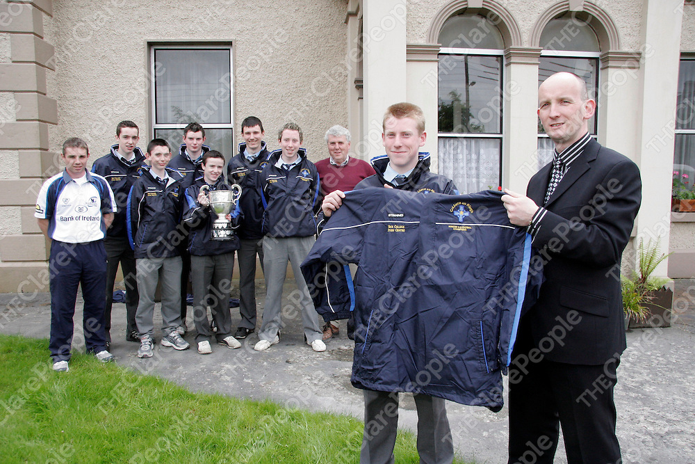 Eoin Hanrahan gets presented with jerseys by John Burns - Vice Principal of Rice College.<br />