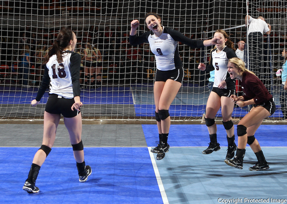 Mount Vernon's Amanda Platte (18), Taylor Dicus (9), Sarah Ryan (5), and Kylea Weber (1) celebrate their win after the fourth game of a 3A semifinal in the state volleyball tournament at the U.S. Cellular Center at 370 1st Ave E on Friday afternoon, November 12, 2010. (Stephen Mally/Freelance)