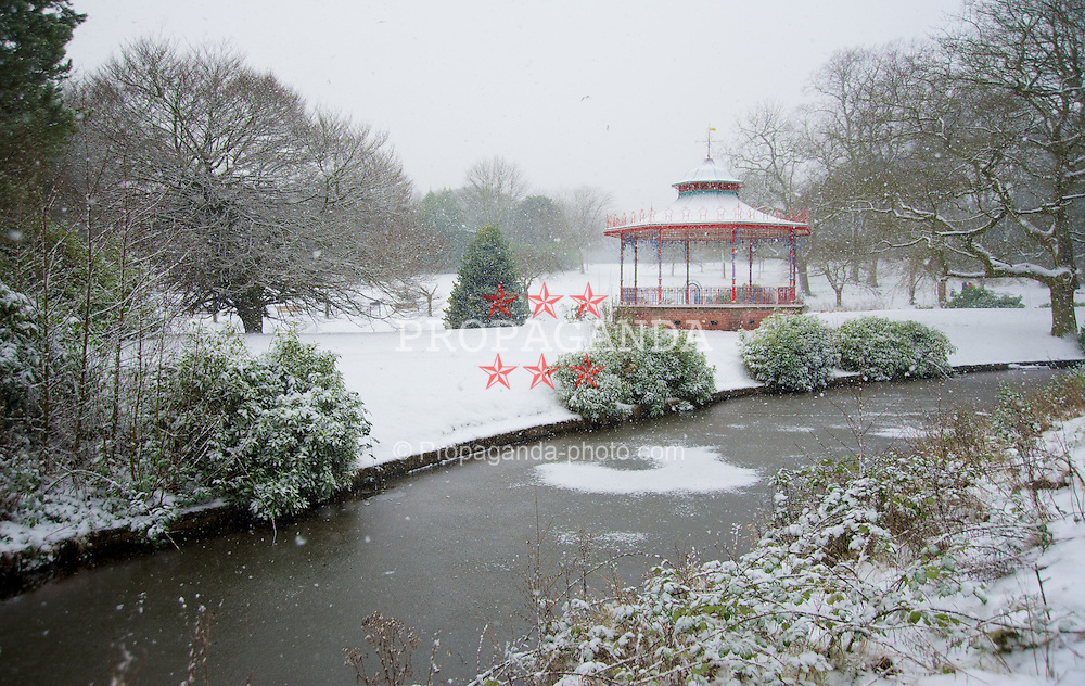 LIVERPOOL, ENGLAND - Friday, January 18, 2013: A band stand covered in snow stands in front of the frozen River Jordan in South Liverpool's Sefton Park. (Pic by David Rawcliffe/Propaganda)