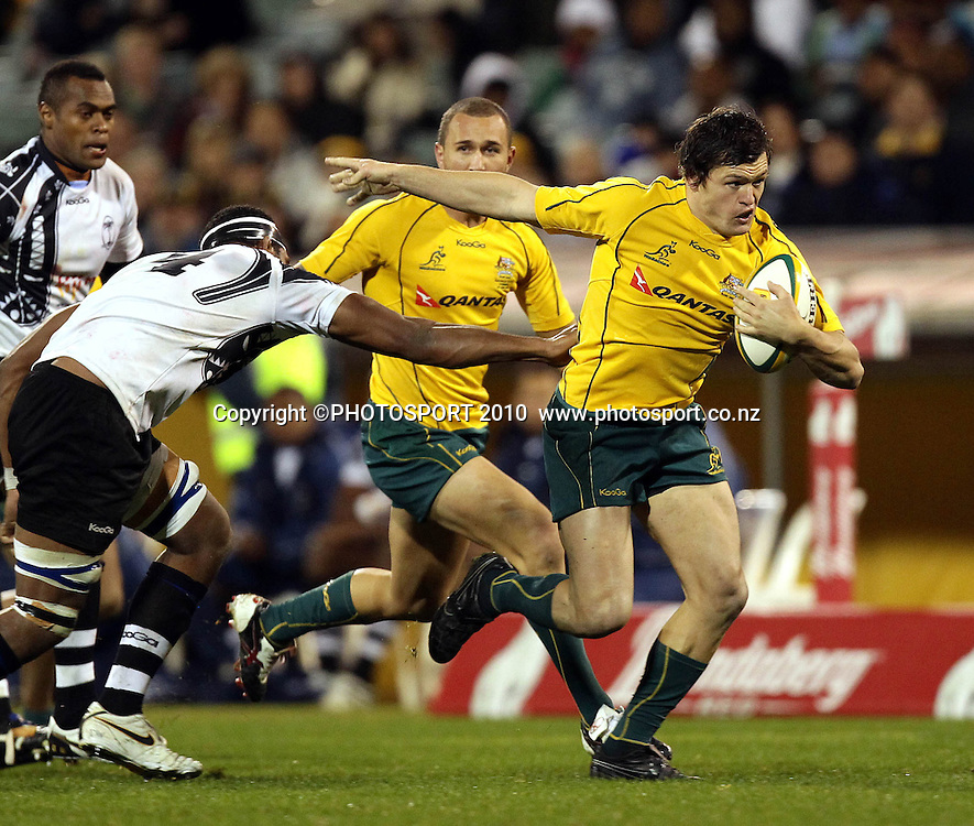 Adam Ashley-Cooper beats Dominiko Waqaniburotu<br /><br />International Test rugby union match, Australia v Fiji, Canberra, Australia. Saturday 5 June 2010. Photo: Paul Seiser/PHOTOSPORT
