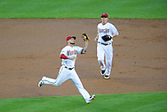 June 14 2011; Phoenix, AZ, USA; Arizona Diamondbacks third basemen Ryan Roberts (14) catches a fly ball hit during the first inning against the San Francisco Giants at Chase Field. Mandatory Credit: Jennifer Stewart-US PRESSWIRE