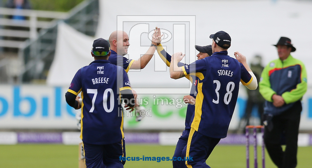 Chris Rushworth (bald head) of Durham County Cricket Club is congratulated on taking a wicket during the Royal London One Day Cup match at Emirates Durham ICG, Chester-le-Street<br /> Picture by Simon Moore/Focus Images Ltd 07807 671782<br /> 06/09/2014