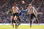 Sunderland defender Patrick Van Aanholt (3)   heads the ball clear during the Barclays Premier League match between Sunderland and Leicester City at the Stadium Of Light, Sunderland, England on 10 April 2016. Photo by Simon Davies.