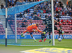 Shane Duffy of Blackburn Rovers (R) scores an own goal for Wigan Athletic's third - Mandatory by-line: Jack Phillips/JMP - 13/08/2016 - FOOTBALL - DW Stadium - Wigan, England - Wigan Athletic v Blackburn Rovers - EFL Sky Bet Championship