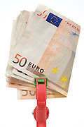 stack of 50 Euro bills in a large clip