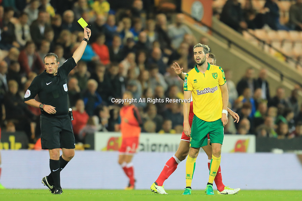 August 8th 2017, Carrow Road, Norwich, England; Carabao Cup First Round; Norwich City versus Swindon Town; The referee yellow cards Mario Vrancic of Norwich City