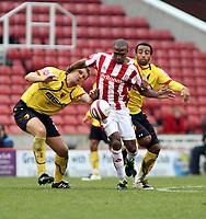 Photo: Mark Stephenson/Sportsbeat Images.<br /> Stoke City v Watford. Coca Cola Championship. 09/12/2007.Stokes Ricardo Fuller holds off Watford's Matt Jackson