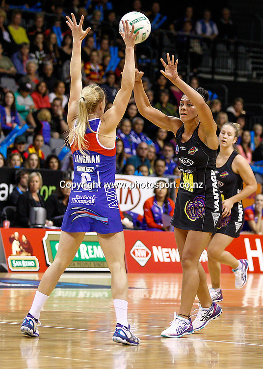 Waikato BOP Magic's Grace Rasmussen fires a pass over Northern Mystic's Laura Langman during the ANZ Championship netball match - Waikato BOP Magic v Northern Mystics at Claudelands Arena, Hamilton, New Zealand on Saturday 20 April 2014.  Photo:  Bruce Lim / www.photosport.co.nz